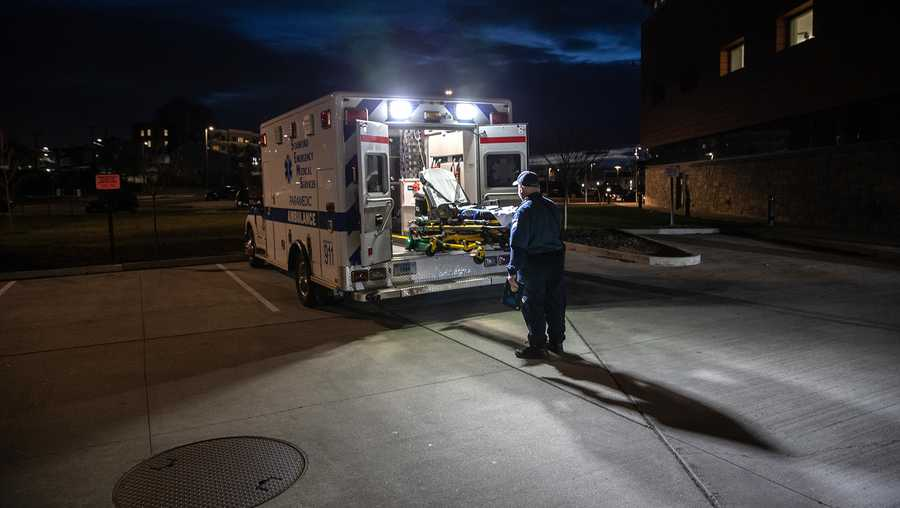 Younger and middle-age Americans have been dying at higher rates over the past three decades. A paramedic loads a cleaned stretcher onto the back of an ambulance before heading out for another call.