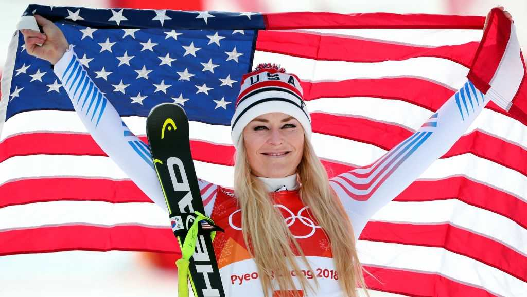 Bronze medallist Lindsey Vonn of the United States celebrates during the victory ceremony for the Ladies' Downhill on day 12 of the PyeongChang 2018 Winter Olympic Games