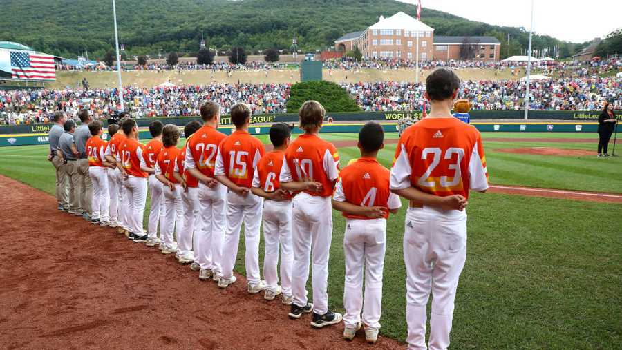 Members of the Southwest Region team from River Ridge Louisiana listen to the national anthem before the start of their game against the Caribbean Region team from Willemstad, Curacao during the Championship Game of the Little League World Series at Lamade Stadium on August 25, 2019 in South Williamsport, Pennsylvania.