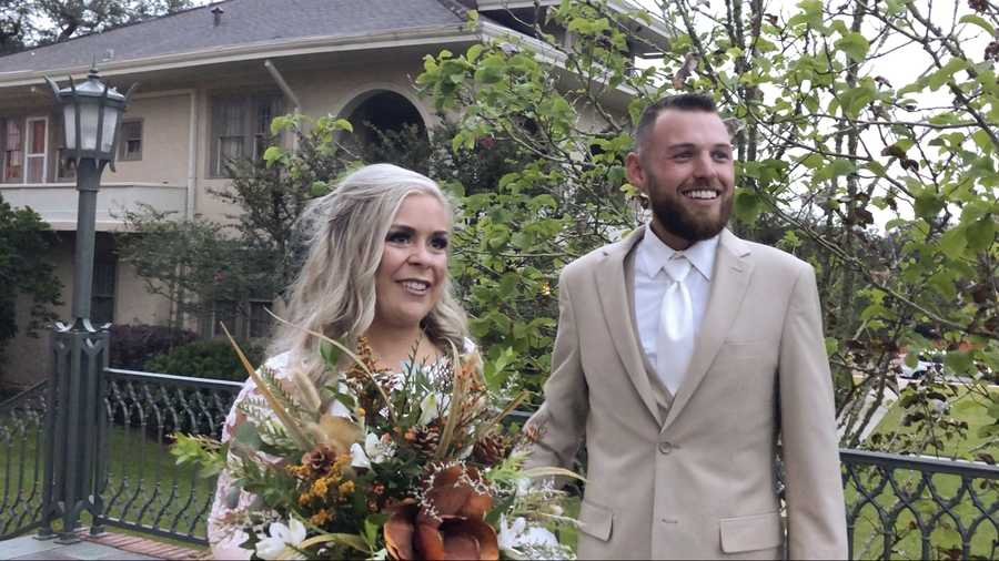 In this image made from video, Ian and Taylor Gaspard from Abbeville speak to a reporter after geting married Thursday, Oct. 8, 2020, in Abbeville, La. Hurricane Delta sped up the Louisiana couple's wedding by a few days but judging by the smiles on the bride and groom it certainly didn't dampen the affair.