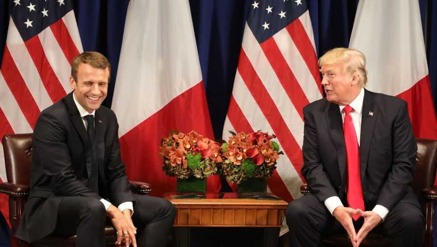 French President Emmanuel Macron shares a light moment with US President Donald Trump speaks during their meeting in New York on the sidelines of the 72nd session of the United Nations General Assembly on September 18, 2017.