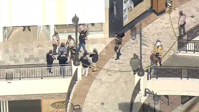 Authorities respond to The Oaks mall in Southern California on Saturday, March 17, 2018, for a shooting in which they say a man killed his former wife.