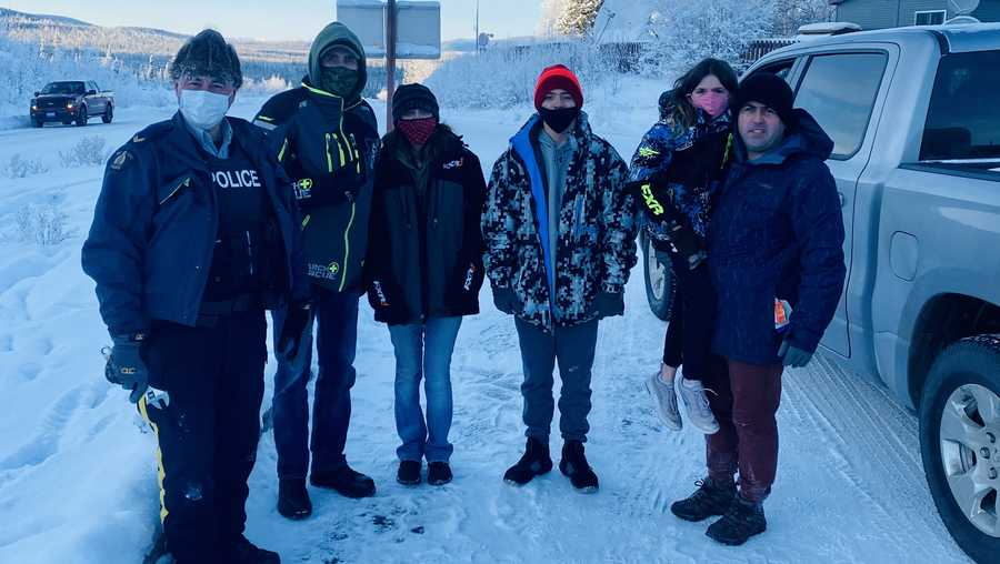 RCMP Cpl. Robert Drapeau stands next to Gary Bath, Lynn Marchessault, Payton Marchessault, Rebecca Marchessault and Tim Marchessault (l to r) near the US-Canadian border crossing.