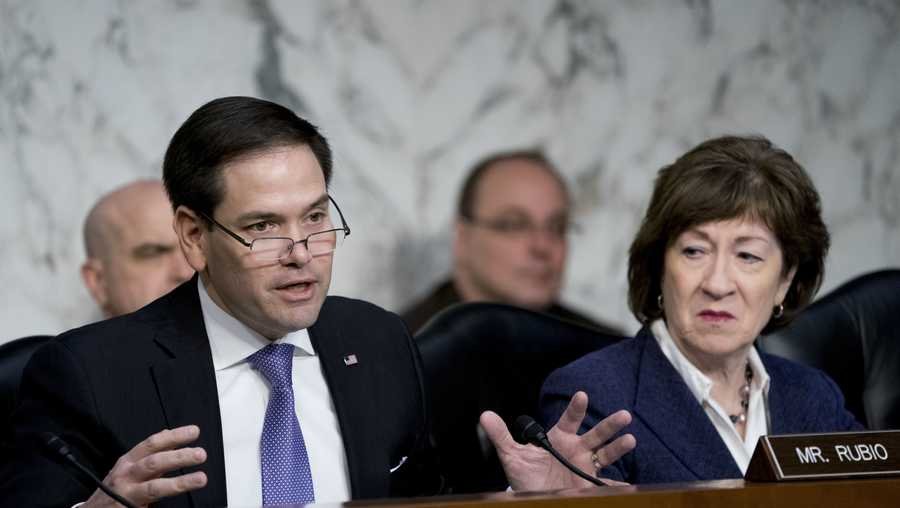 In this March 21, 2018 file photo, Sen. Marco Rubio, R-Fla., left, accompanied by Sen. Susan Collins, R-Maine, right, speaks before a Senate Intelligence Committee hearing on election security on Capitol Hill in Washington.