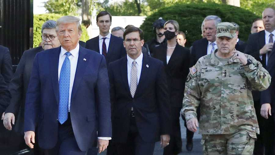 "In this June 1, 2020 file photo, President Donald Trump departs the White House to visit outside St. John's Church, in Washington. Part of the church was set on fire during protests on Sunday night. Walking behind Trump from left are, Attorney General William Barr, Secretary of Defense Mark Esper and Gen. Mark Milley, chairman of the Joint Chiefs of Staff. Milley says his presence ""created a perception of the military involved in domestic politics."" He called it ""a mistake"" that he has learned from."