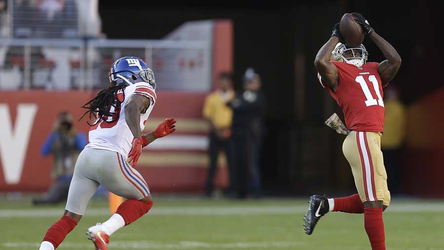 San Francisco 49ers wide receiver Marquise Goodwin (11) catches a touchdown pass in front of New York Giants cornerback Janoris Jenkins, left, during the first half of an NFL football game in Santa Clara, Calif., Sunday, Nov. 12, 2017.