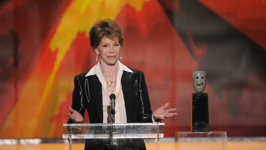 Mary Tyler Moore accepts the Life Achievement award at the 18th Annual Screen Actors Guild Awards on Sunday Jan. 29, 2012 in Los Angeles.