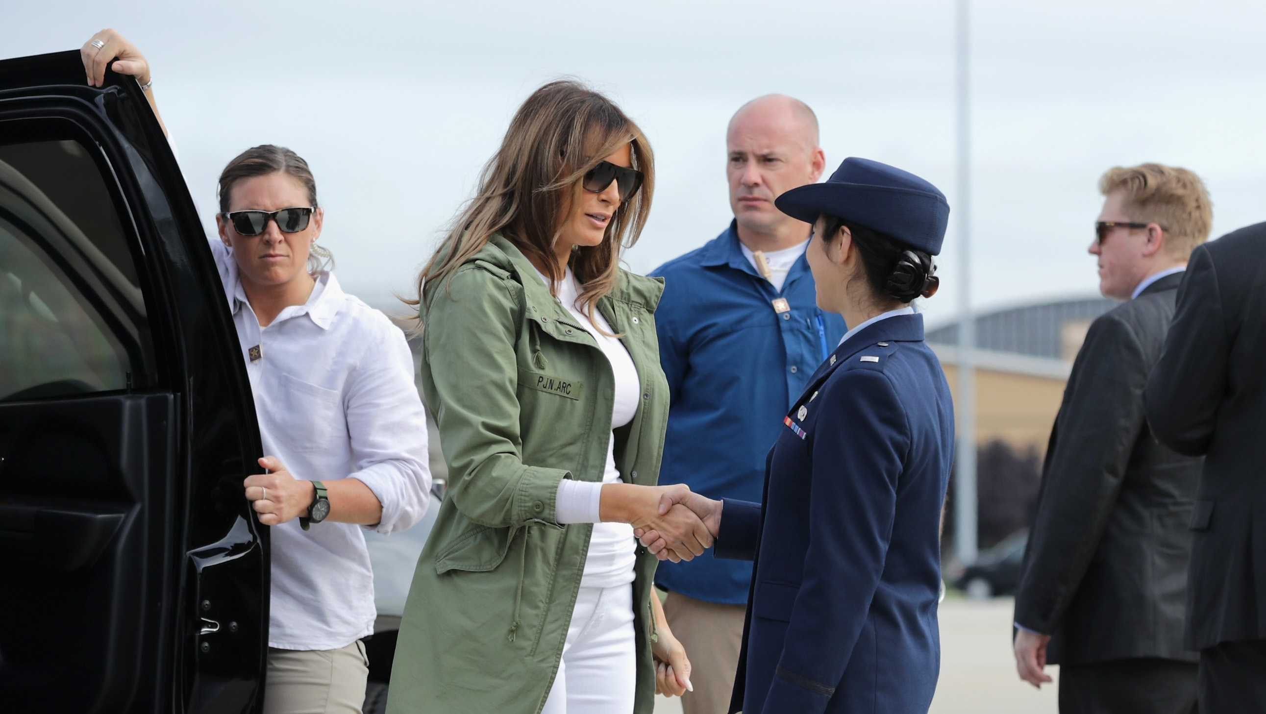 First Lady Melania Trump steps out of her motorcade before boarding an Air Force plane and traveling to Texas to visit facilities that house and care for children taken from their parents at the U.S.-Mexico border June 21, 2018 at Joint Base Andrews, Maryland.​