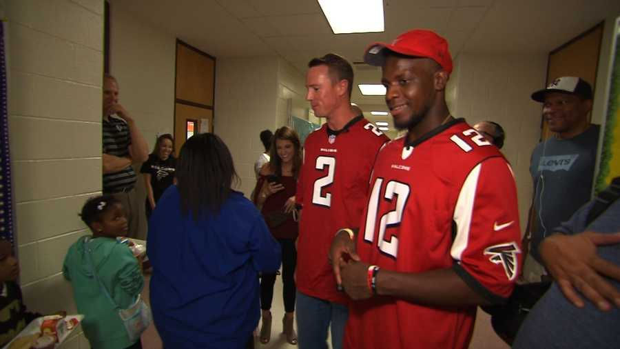 (FILE PHOTO: Mohamed Sanu with Falcons QB Matt Ryan) Atlanta Falcons wide receiver Mohamed Sanu tweeted a photo of a note he received from fellow passengers on a recent flight. The family thanked Sanu for setting a positive example for their son.