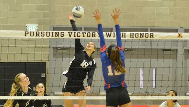 Mount Madonna School's Eve Willis goes for a kill in the CIF Division V State Championship on November 22 in Orange. (Photo by Ward Mailliard)