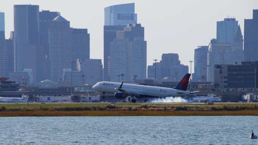 Delta with city of Boston in Background