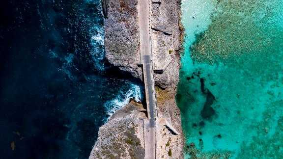 The Glass Window bridge on the Bahamian island of Eleuthera separates the dark blue Atlantic Ocean and the turquoise Bight of Eleuthera.