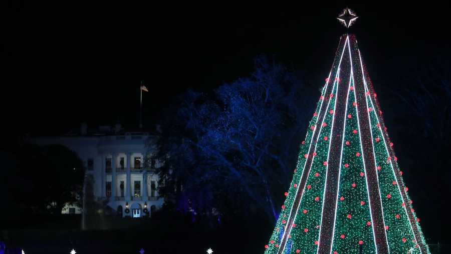 The National Christmas Tree is lit during a ceremony held by the National Park Service at the Ellipse near the White House on Nov. 28, 2018, in Washington.