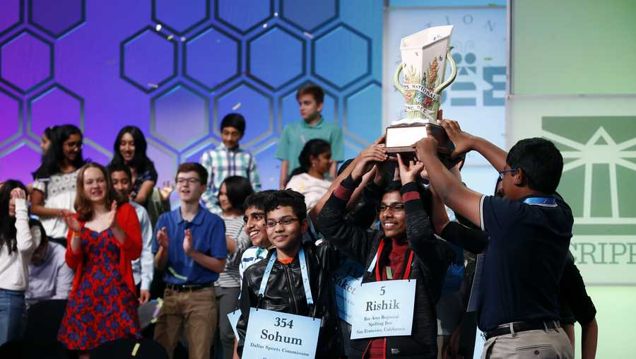 "In this May 31, 2019 file photos, eight co-champions celebrate after winning the Scripps National Spelling Bee, in Oxon Hill, Md. The Scripps National Spelling Bee has been canceled after organizers concluded there was ""no clear path to safely set a new date in 2020"" because of the coronavirus pandemic."