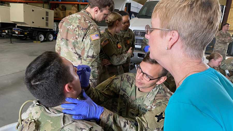 Medics with the Louisiana Army and Air National Guard conduct training with the Department of Health and Human Services to ensure proper protection and administering of drive thru testing, March 18, 2020 in New Orleans. (U.S. Army National Guard photo by Maj. John Meche)