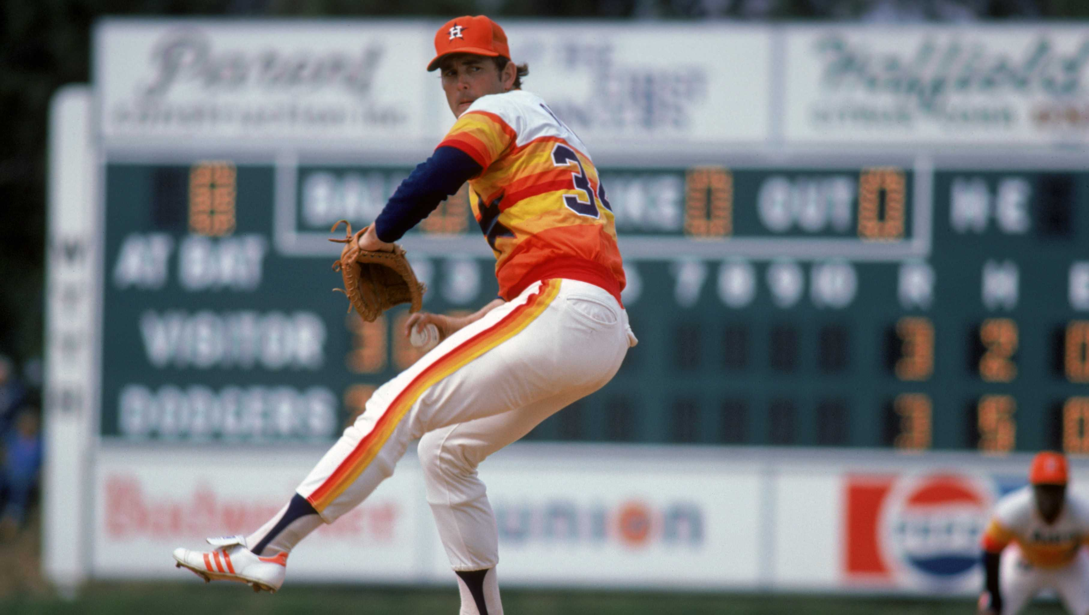 Nolan Ryan #34 of the Houston Astros winds up a pitch during a 1980 season game.
