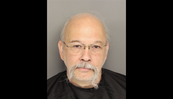 Norman Earl Gardner, Jr., 56, is charged with reckless driving in a road rage incident that ended in a crash that critically injured a 13-year old boy.