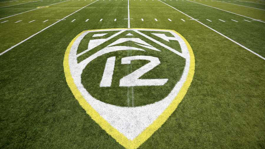 In this Oct. 10, 2015, file photo, a PAC-12 logo is displayed on the field before an NCAA college football game between Washington State and Oregon in Eugene, Ore.
