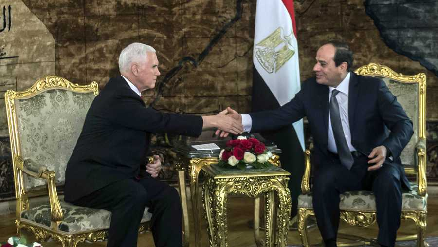 U.S. Vice President Mike Pence shakes hands with Egyptian President Abdel-Fattah el-Sissi, right, at the Presidential Palace in Cairo, Egypt, Saturday, Jan. 20, 2018.