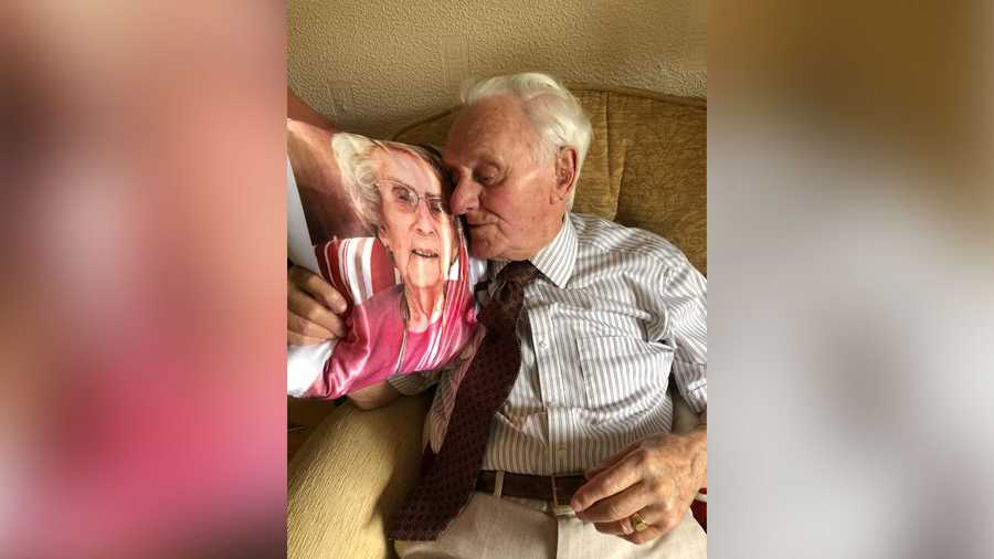 Ken Benbow was surprised when he was given a pillow with his late wife's face on it. He clutched the gift, and a brief smile gave way to tears.