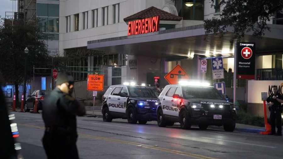 Emergency vehicles outside Memorial Hermann Hospital in the Texas Medical Center where injured officers were transported following a shooting Monday.