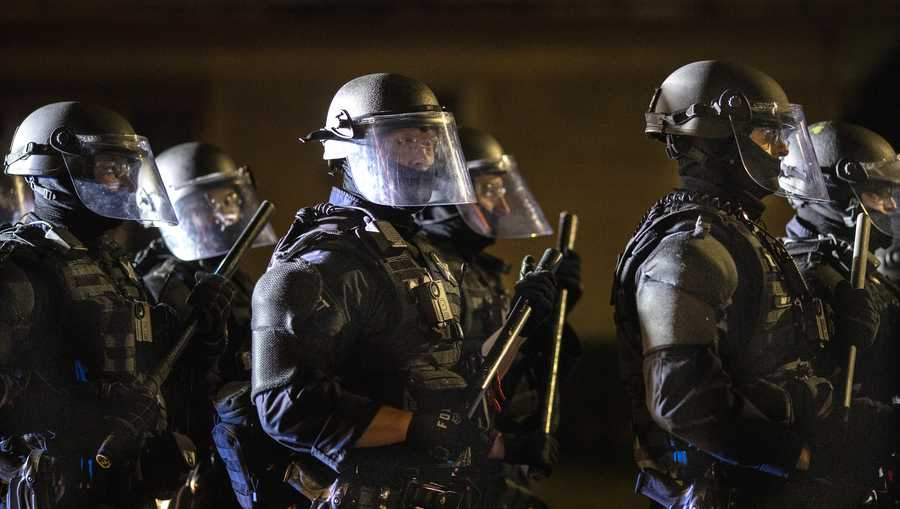 Portland police take control of the streets after making arrests on the scene of the nightly protests at a Portland police precinct on Sunday, Aug. 30, 2020 in Portland, Ore.