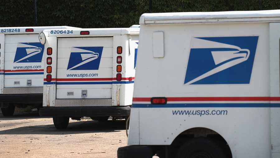 CHICAGO, ILLINOIS - AUGUST 15: United States Postal Service (USPS) trucks are parked at a postal facility on August 15, 2019 in Chicago, Illinois. In its recent quarterly statement the USPS reported a loss of nearly $2.3 billion and a 3.2 percent decline in package deliveries, the first decline in nearly a decade.  (Photo by Scott Olson/Getty Images)