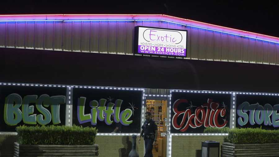 Houton Police Department officials investigate a robbery at the Exotic Adult Superstore on 15000 block of Eastex Freeway Service Road on Thursday, Aug. 23, 2018, in Humble. Police chased the suspects with vehicle and on foot on U.S. 59. One suspect was taken into custody and three escaped.