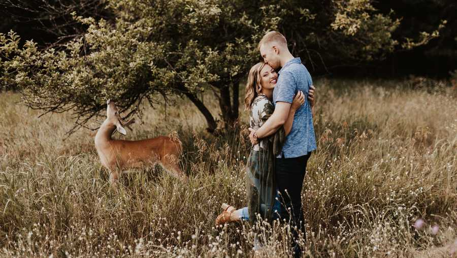 A surprise visitor wanders onto the Michigan engagement photo session of Dori Castignola and Austin Swiercz. Photographer Eldina Kovacevic of Inna Kova Photography said she told the couple to stay calm as she captured the moment.