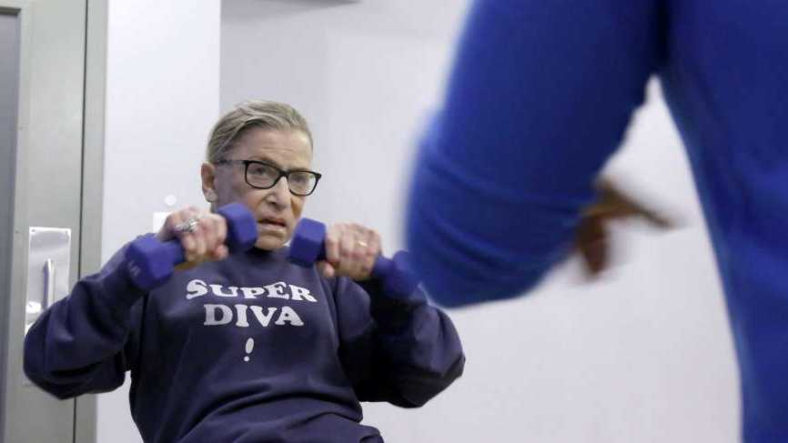"This image released by Magnolia Pictures shows U.S. Supreme Court justice Ruth Bader Ginsberg working out in a scene from ""RBG."""