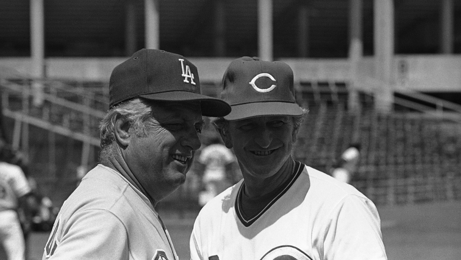Los Angeles Dodgers manager Tommy Lasorda talks with Cincinnati Reds manager John McNamara while the two teams took batting practice in Tampa, Fla., Tuesday, March 18, 1980. (AP Photo/Kennedy)