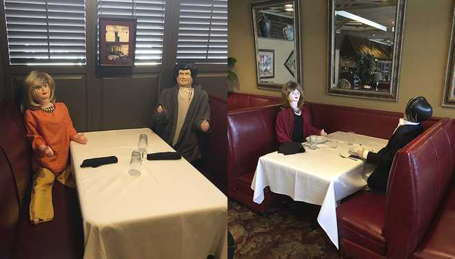 dolls placed at tables not being used because of social distancing at open hearth restaurant