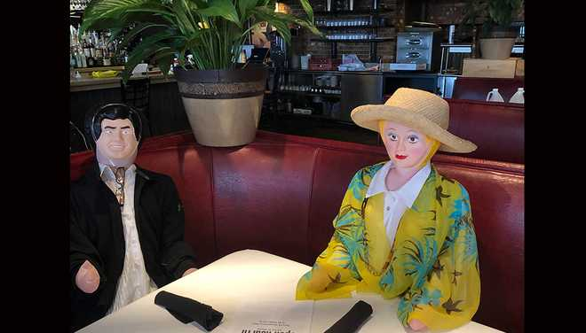 dolls dressed as customers as open hearth restaurant reopens
