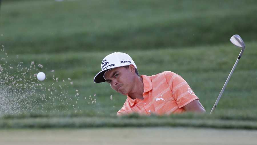 Rickie Fowler hits out of a bunker on the 18th hole the Honda Classic golf tournament, Sunday, Feb. 26, 2017, in Palm Beach Gardens, Fla.