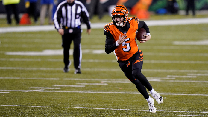 Cincinnati Bengals quarterback Ryan Finley (5) runs for a touchdown during the second half of an NFL football game against the Pittsburgh Steelers, Monday, Dec. 21, 2020, in Cincinnati. (AP Photo/Bryan Woolston)