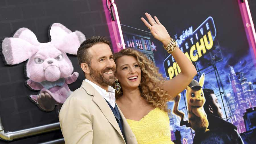 "Actor Ryan Reynolds, left, is joined by his pregnant wife, actress Blake Lively at the premiere of ""Pokemon Detective Pikachu"" at Military Island in Times Square on Thursday, May 2, 2019, in New York."