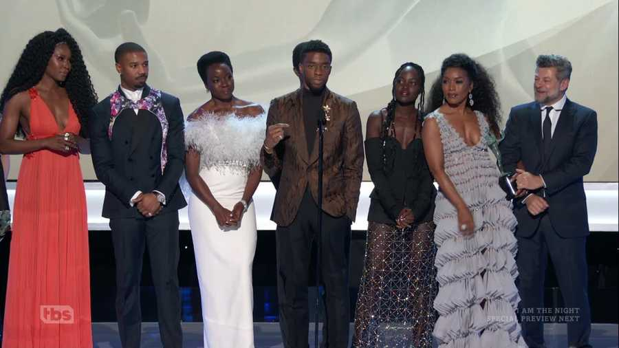 The cast of Black Panther (2018) on stage at the 2019 SAG Awards accepting the award for Best Ensemble.