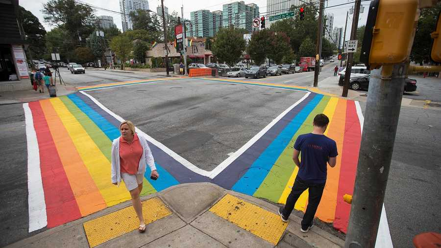 Pedestrians cross a rainbow painted crosswalk in midtown to commemorate the annual Atlanta Pride parade.