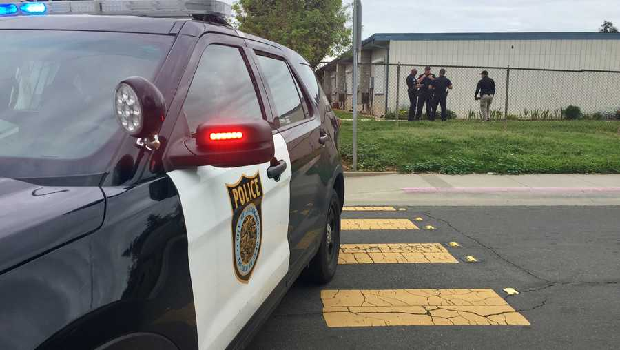 Sacramento police investigate on Wednesday, April 3, 2019, after a building on the the New Joseph Bonnheim Charter School campus was hit by bullets.
