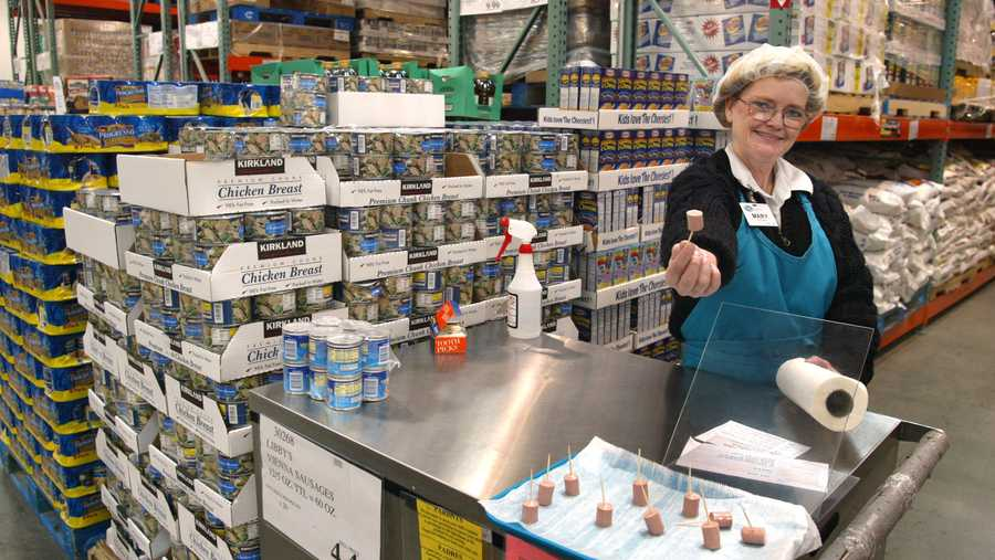 Mary LaRocca offers a sample of Libby's Vienna Sausage in a Costco Wholesale store March 8, 2002 in Niles, IL. Free samples will no longer be offered at a number of Costco stores over virus concerns.