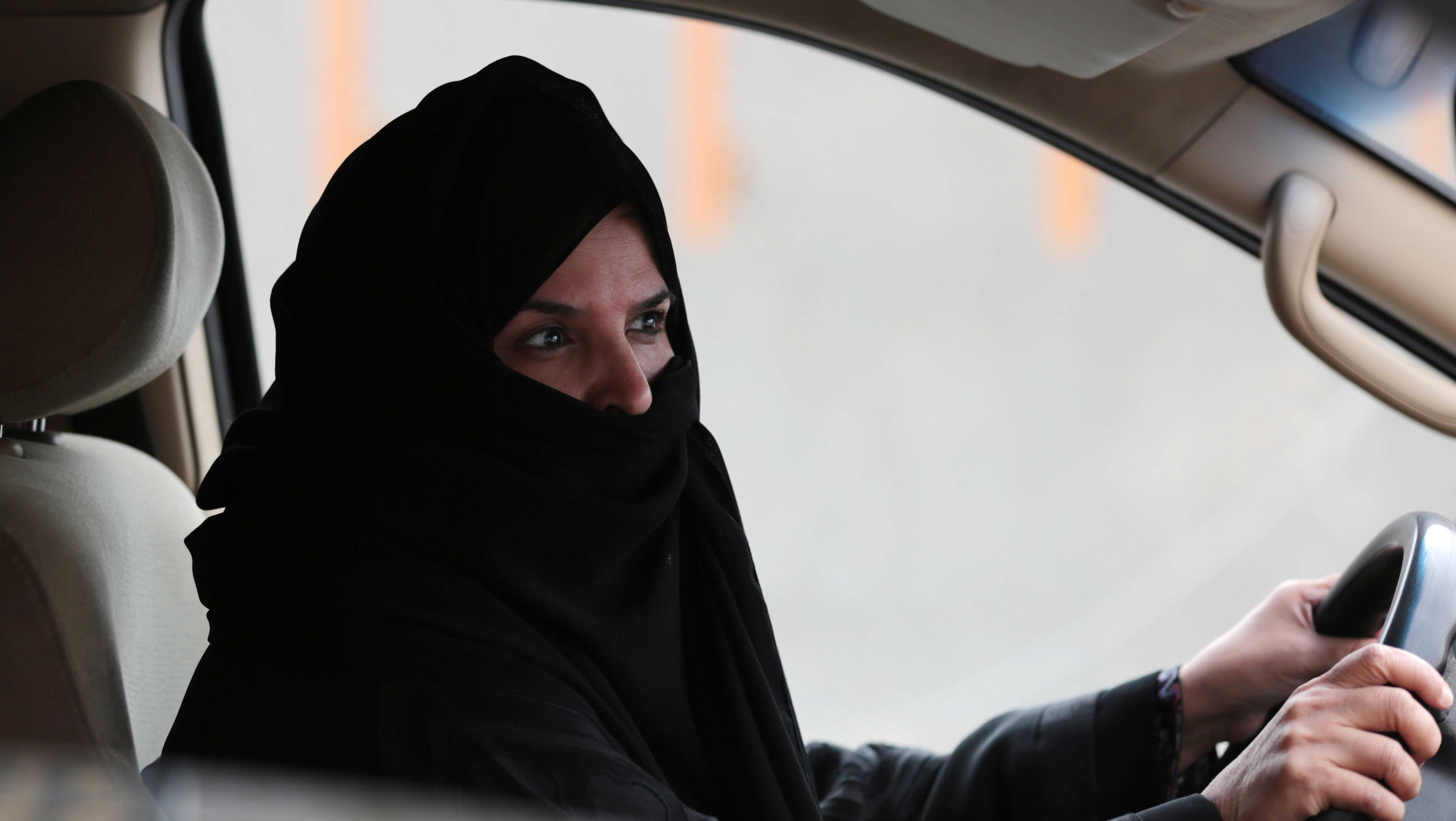 Aziza Yousef drives a car on a highway in Riyadh, Saudi Arabia, Saturday March 29, 2014, as part of a campaign to defy Saudi Arabia's ban on women driving.
