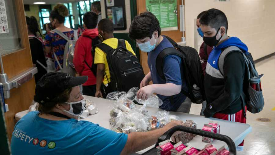 Students pick up individually wrapped meals during lunch period at Rippowam Middle School on September 14, 2020 in Stamford, Connecticut.