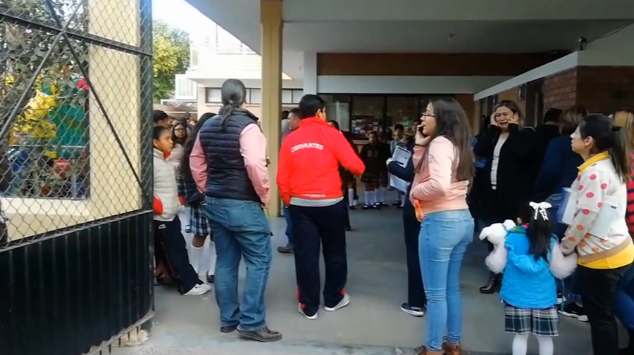Anxious relatives arrive at a private school in Mexico to pick up students after a shooting Friday, as shown by news footage from affiliate TV Azteca.
