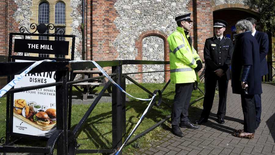 Theresa May stands outside The Mill pub and views the area where former Russian double agent Sergei Skripal and his daughter were found critically ill, in Salisbury, England on March 15, 2018.
