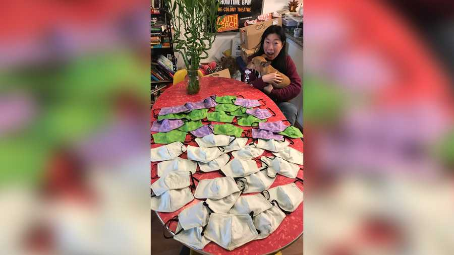 Kristina Wong of Los Angeles poses with her first batch of masks she made for a fire unit in New York.