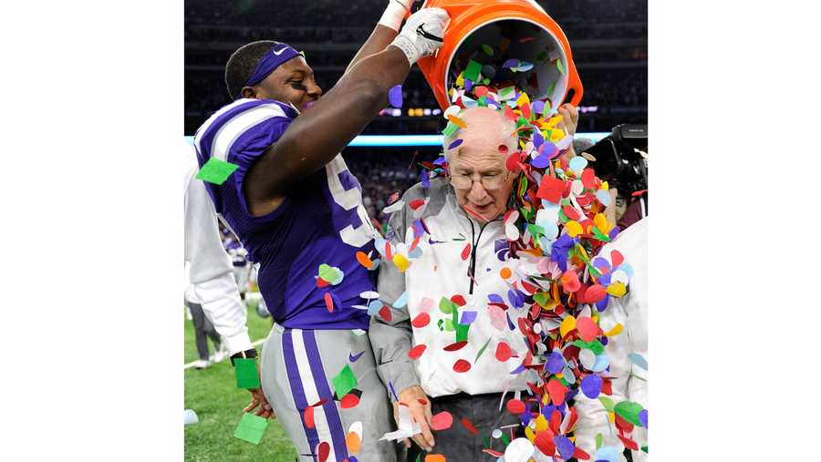 Kansas State coach Bill Snyder, right, is showered with confetti by Charmeachealle Moore after Kansas State defeated Texas A&M 33-28 in the Texas Bowl NCAA college football game, Wednesday, Dec. 28, 2016, in Houston. (AP Photo/Eric Christian Smith)