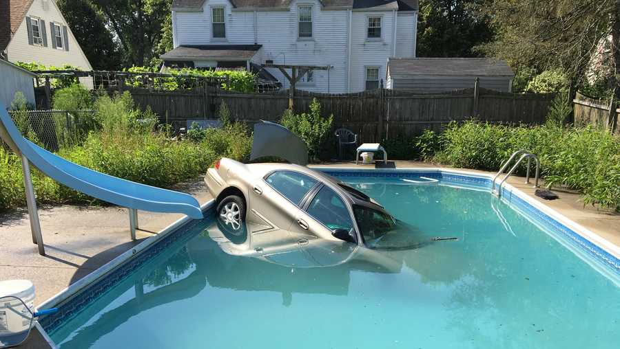 Car ends up in swimming pool