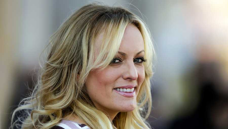 "In this Oct. 11, 2018, file photo, adult film actress Stormy Daniels attends the opening of the adult entertainment fair ""Venus,"" in Berlin."