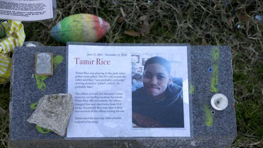 In this Dec. 13, 2020, file photo a memorial for Tamir Rice is seen at the base of the Gen. Robert E. Lee statue is seen Sunday Dec. 13, 2020 in Richmond, Va. The Justice Department announced Tuesday, Dec. 29, 2020, that it would not bring federal criminal charges against two Cleveland police officers in the 2014 killing of 12-year-old Tamir Rice, saying video of the shooting was of too poor a quality for prosecutors to conclusively establish what had happened. (AP Photo/Jacqueline Larma, File)