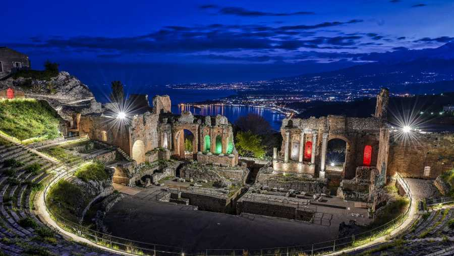 The Greek theatre in Taormina is shown at sunset with no visitors following the restrictions imposed by the government in response to the coronavirus. Normally, every day of the year and especially at Easter, the theater is always visited by many tourists on April 8, 2020 in Taormina, Italy.